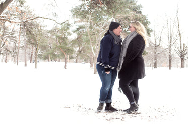two women laugh in the snow