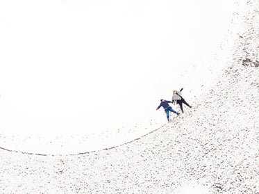 two women making snow angels