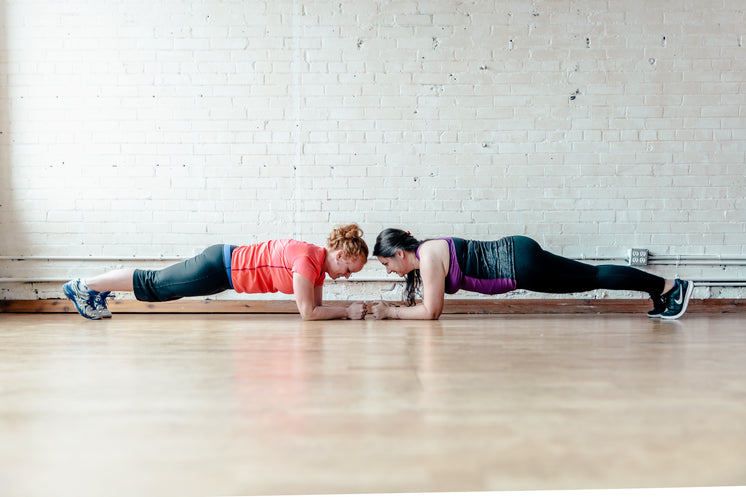 Two Women Planking Together
