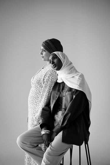two women pose in black and white
