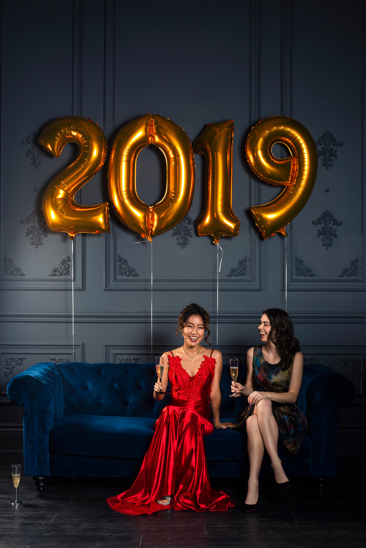 Two Women Toast To 2019 With Champagne