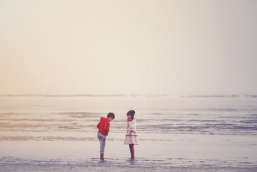 two young people share a happy moment on a beach