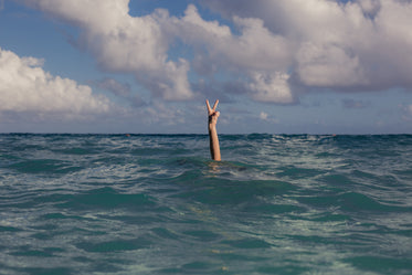 vacation peace sign in ocean