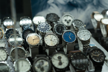 variety of watches lined up in rows
