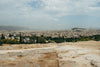 view of the city from a rocky hilltop