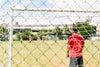 view though lines of a soccer net during game