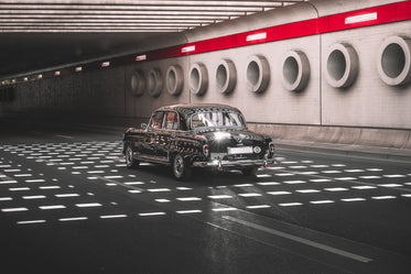 vintage car driving through stunning underpass