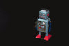 vintage robot with lots of black negative space