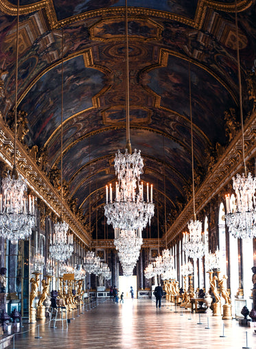 visitors walking through the hall of mirrors