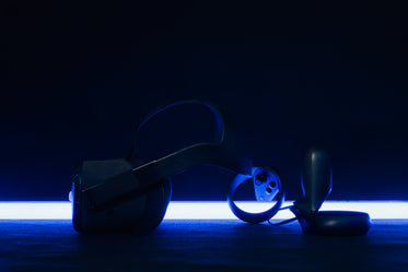 vr headset and controllers backlit by blue light