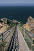 Browse Free HD Images of Walking Bridge To Lighthouse By Pacific Ocean