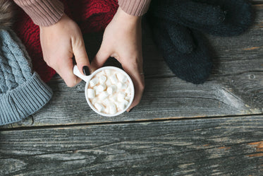 warming hands on hot cocoa