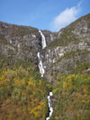 waterfall over rocky cliff