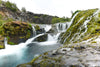 waterfall over rocky shores