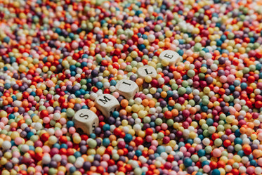white blocks laying in colorful dots spells out smile