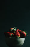 white bowl filled with red ripe strawberries