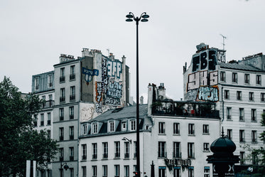 white buildings with graffiti covering the sides