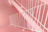 white metal railings cross pink stairs and landings