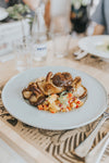 white plate with mushrooms and vegetables