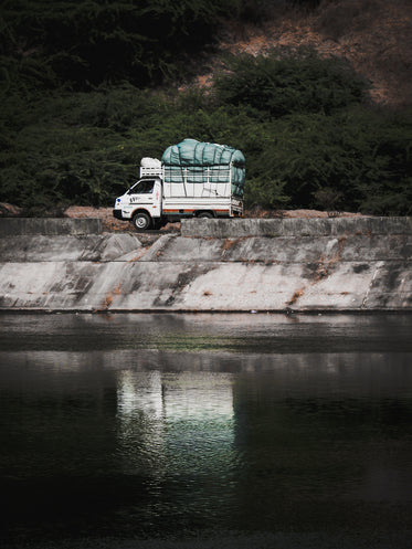 white truck parked by the water