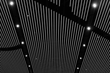 white vertical lines on a black ceiling