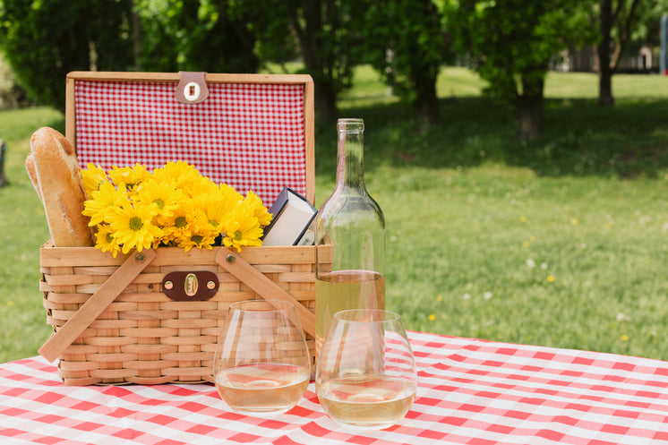 White Wine And Picnic Basket With Flowers