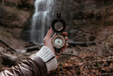 wide shot of compass and waterfalls