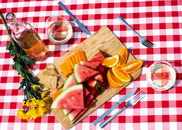 wine and fruit on picnic table