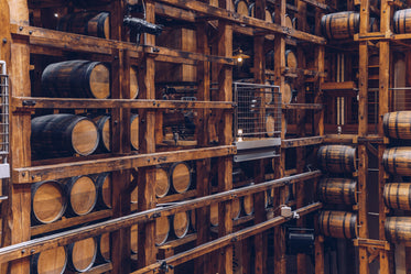 Free Wine Barrels In Wooden Structure Photo — High Res Pictures