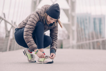 female athlete tying her shoes