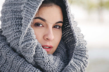 woman draped in knit scarf