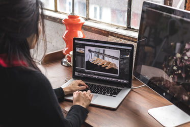 woman edits images on her laptop