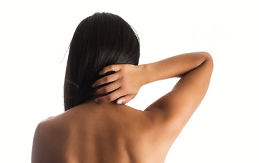 woman hand on back neck