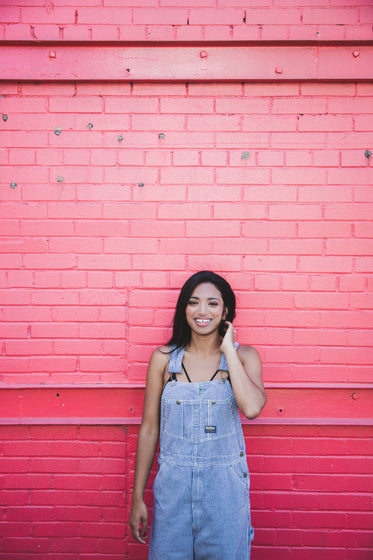 woman happy pink wall portrait