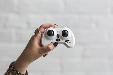 woman holding controller