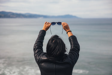 Picture of Woman Holding Sunglasses - Free Stock Photo