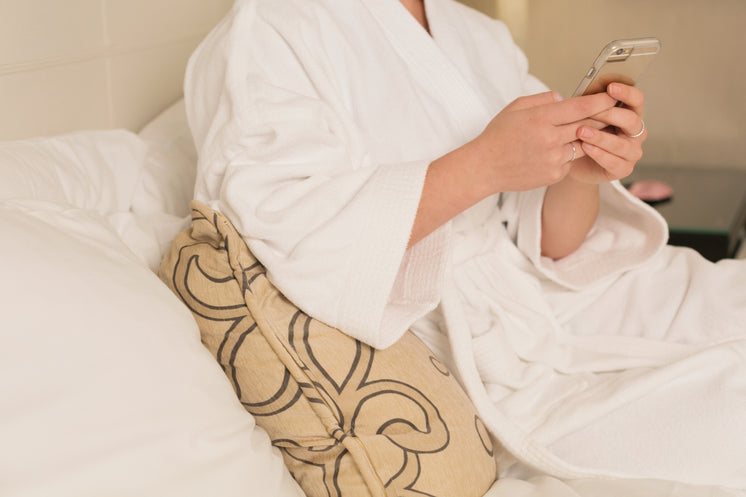 Woman In Bathrobe With Phone
