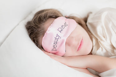 woman in beauty rest mask in pillow
