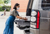 woman in face mask during curbside pickup