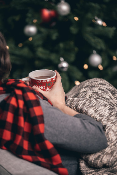 woman in scarf drinking hot chocolate