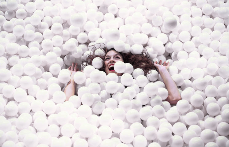 Woman Is Swallowed Up By A Pool Of Styrofoam Balls