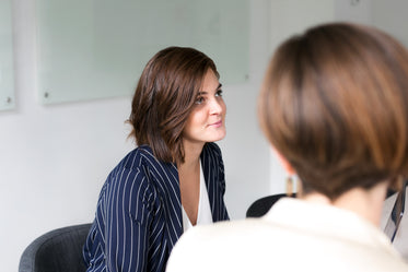 woman listening at team meeting