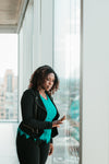woman looking out woman from highrise office
