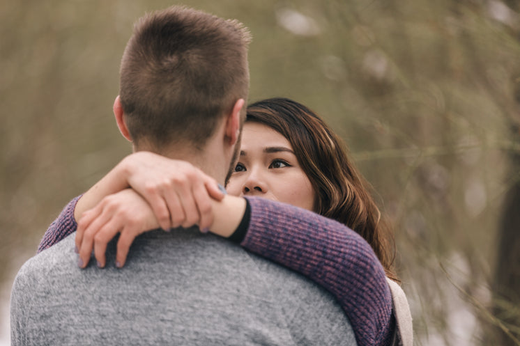 Woman Looks Deep Into Her Partner's Eyes