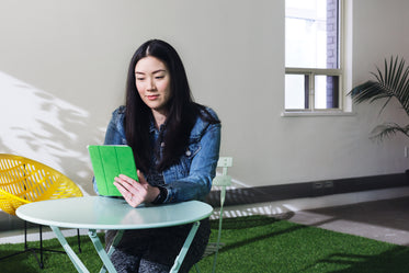 Picture of Woman On Tablet Patio — Free Stock Photo