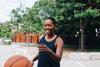 woman playing basketball in the street