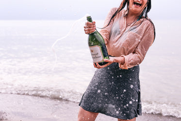 Picture of Woman Popping Champagne - Free Stock Photo