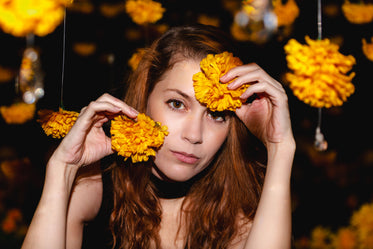 woman poses with orange blossoms