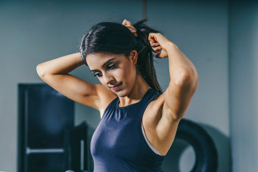 woman prepares for workout