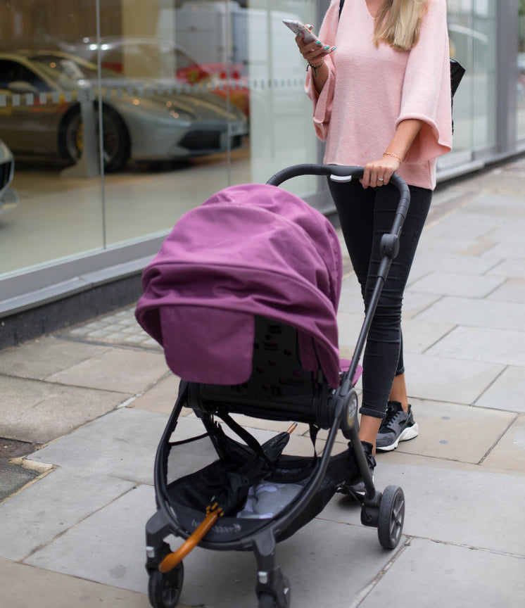 Woman Pushes Stroller While Using Phone
